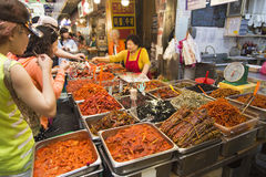 Seoul, Republic of Korea - 5 May 2015: People queing and tasting Royalty Free Stock Photo