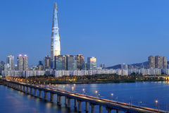 Seoul skyline, Korea. Jamsil bridge over Han River against Seoul Skyline at the blue hour. In the back is the Lotte Tower, the tallest building in Republic of Stock Image