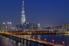 Seoul skyline, Korea. Jamsil bridge over Han River against Seoul Skyline at night. In the back is the Lotte Tower, the tallest building in Republic of Korea Stock Image