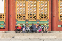 Seoul,south korea-11 april,2016: Beautiful gate with children ta. Beautiful gate with children talking and playing in gyeoungbokbung palace Royalty Free Stock Image