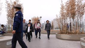 Asian torists walking at spring park, Seoul, South