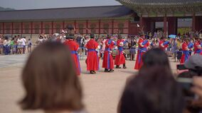SEOUL, SOUTH KOREA - AUGUST 28, 2019: Ceremony of changing of the Royal Guard at Gyeongbokgung palace. Slow motion shot