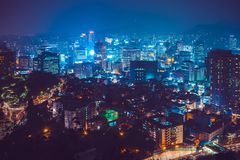 SEOUL, SOUTH KOREA - AUGUST 11, 2015: Skyscrapers of Myeong-dong area near famous Namsan tower - Seoul, South Korea. SEOUL, SOUTH KOREA - AUGUST 11, 2015 Stock Images