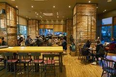 Starbucks. SEOUL, SOUTH KOREA - CIRCA MAY, 2017: inside Starbucks in Seoul. Starbucks Corporation is an American coffee company and coffeehouse chain Stock Image
