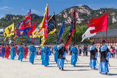 Seoul, South Korea - circa September 2015: Palace guards marching in traditional Korean dresses in Gyeongbokgung Palace, Seoul,  K Royalty Free Stock Image