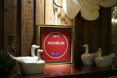 Seoul, South Korea - 19 January 2019: Michelin Plaque 2017 at asian restaurant stock image