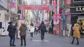 Timelapse at Myeong-dong Market.People walking on a shopping street at night stock video footage