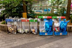 Free Seoul, South Korea - June 20, 2017: Waste Sorting Containers With Colored Inscriptions For Plastic, Glass Bottles And Paper Stock Photo - 176892260