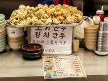 Seoul, South Korea - June 21, 2017: Dumplings - Mandu is the most popular Korean food at Gwangjang Market in Seoul.  royalty free stock photo