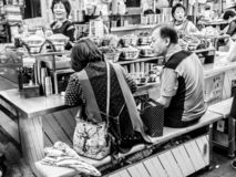 Seoul, South Korea - June 21, 2017: People eating tasty food and drink at Gwangjang Market in Seoul stock photo