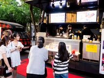 Seoul, South Korea - June 3, 2017: People queuing up at the fast food kiosk at the street near Cheonggyecheon stream in Seoul stock images