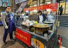 Man selling food at Myeongdong open street market in Seoul Stock Photo