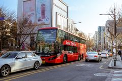Seoul City Tour Bus at Hongdae Shopping district in Seoul city. Seoul, South Korea - March 2, 2018 : Seoul City Tour Bus at Hongdae Shopping district Royalty Free Stock Photography
