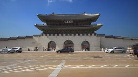 Seoul, South Korea - May 28, 2018: transport moving along Gwanghwamun Gate in Gyeongbokgung Palace, with the name of the