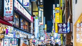 Timelapse at Myeong-dong Market.People walking on a shopping street at night stock video