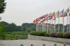 1988 Seoul, South Korea Olympic Park summer games with global flags flying on a cloudy day with the green park in background on royalty free stock photo