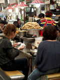 Seoul Street Food. Visitors and locals alike enjoy a quick meal at Dongdaemun market in Seoul Stock Photo