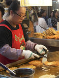 Seoul Street Food. A woman prepares street food at Dongdaemun Market in Seoul Royalty Free Stock Photography
