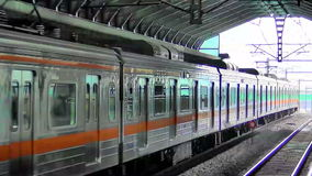 Seoul Subway. Train with orange details entering covered station in Seoul,  South Korea stock video