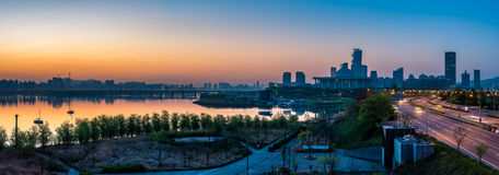 Seoul Sunrise. Panorama of the sun rising over the Han River and the National Assembly of South Korea in Seoul Stock Image
