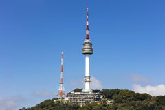 Seoul tower Located on Namsan Mountain. With blue sky white clouds  in Seoul, South Korea Stock Image