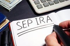 Sep-ira met de hand geschreven op een pagina Pensioneringsplan royalty-vrije stock fotografie