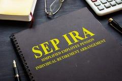 SEP IRA Simplified Employee Pension Individual Retirement Arrangement. SEP IRA Simplified Employee Pension Individual Retirement Arrangement on the desk stock photo