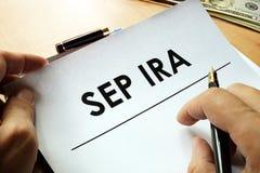 SEP IRA Simplified Employee Pension. SEP IRA Simplified Employee Pension written on a paper stock photo