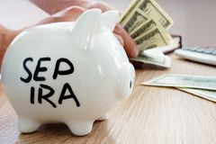SEP IRA written on a side of piggy bank. Pension plan. SEP IRA written on a side of the piggy bank. Pension plan royalty free stock photography