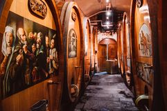 Underground wine cellar with rows of big oak barrels. SEP 25, 2013 Lavaux, Switzerland - Old rustic underground wine cellar with rows of big oak barrels. Famous stock image