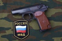 Sep. 21, 2017. Russian Police uniform badge with handgun Makarov on camouflage uniform. Sep. 21, 2017. Russian Police uniform badge with 9mm handgun Makarov on stock photos