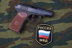 Sep. 21, 2017. Russian Police uniform badge with handgun Makarov on camouflage uniform. Sep. 21, 2017. Russian Police uniform badge with 9mm handgun Makarov on royalty free stock image