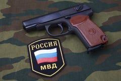 Sep. 21, 2017. Russian Police uniform badge with handgun Makarov on camouflage uniform. Sep. 21, 2017. Russian Police uniform badge with 9mm handgun Makarov on royalty free stock photo