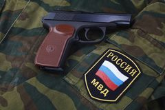 Sep. 21, 2017. Russian Police uniform badge with handgun Makarov on camouflage uniform. Sep. 21, 2017. Russian Police uniform badge with 9mm handgun Makarov on royalty free stock photography
