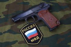 Sep. 21, 2017. Russian Police uniform badge with handgun Makarov on camouflage uniform. Sep. 21, 2017. Russian Police uniform badge with 9mm handgun Makarov on stock images