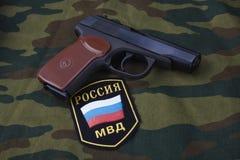 Sep. 21, 2017. Russian Police uniform badge with handgun Makarov on camouflage uniform. Sep. 21, 2017. Russian Police uniform badge with 9mm handgun Makarov on royalty free stock photos