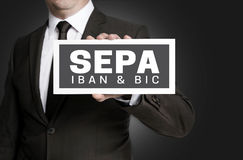 Sepa sign is held by businessman Royalty Free Stock Photos