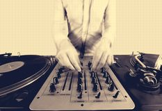 Sepai halftone image of a funky female dj. Mixing on turntables stock photo
