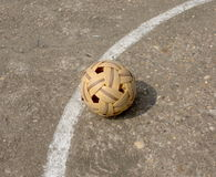 Sepaktakraw, the popular sport of southeast asia. Takraw on concrete field in the game Royalty Free Stock Photo