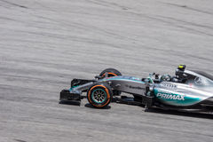 SEPANG - 27 ΜΑΡΤΊΟΥ: Nico Rosberg στην τελευταία καμπύλη Στοκ Φωτογραφία