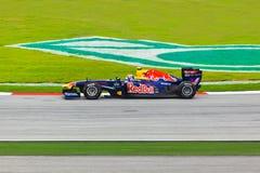 SEPANG, МАЛАЙЗИЯ - 10-ОЕ АПРЕЛЯ: Отметьте Webber (гонки Bull команды красные) Стоковое Фото