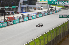 SEPANG, МАЛАЙЗИЯ - 8-ОЕ АПРЕЛЯ: Sergio Perez (команда Sauber) вначале Стоковое Изображение RF