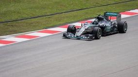 SEPANG - 27-ОЕ МАРТА: Nico Rosberg перед последней кривой Стоковое фото RF