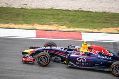 SEPANG - 28 DE MARZO: Daniel Ricciardo en la curva pasada Fotos de archivo libres de regalías