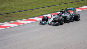 SEPANG - 27. MÄRZ: Nico Rosberg vor letzter Kurve Lizenzfreies Stockfoto