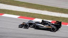 SEPANG - 27. MÄRZ: Sergio Perez in der letzten Kurve Lizenzfreies Stockbild