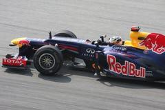 Petronas Malaysian Grand Prix F1 2012. SEPANG, MALAYSIA - MARCH 23: Close up Sebastian Vettel of Red Bull Racing team in action at PETRONAS Malaysian Grand Prix Royalty Free Stock Images