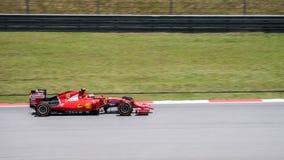 SEPANG - MARCH 27: Kimi Räikkönen in sector 2. SEPANG - MARCH 27: Kimi Räikkönen of Scuderia Ferrari at 2015 Formula 1 Petronas Malaysia Grand Prix Second Royalty Free Stock Photo