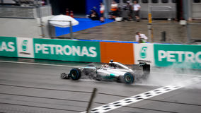 SEPANG - MARCH 29: Lewis Hamilton Driving Pass Finish line in ra Royalty Free Stock Photography