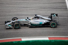 SEPANG - MARCH 28: Lewis Hamilton in last curve Royalty Free Stock Photo